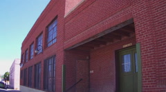 Old Fashioned Red Brick Factory Warehouse- Silver City NM - stock footage