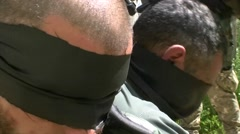 Captured prisoners by the islamic extremists Stock Footage