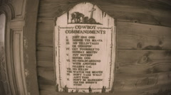 Stock Video Footage of Cowboy Commandments On Old West Church- Sepia Tone