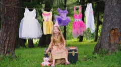 Little Girl Playing Princess Outside with Costumes - stock footage