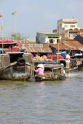 Fresh produce vendors sell from boat to boat - stock photo