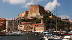 Stock Video Footage of The harbor and Citadel at Bonifacio, Corsica, France