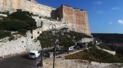 Traffic enters the Citadel at Bonifacio, Corsica, France - stock footage