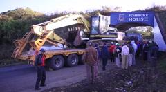 Truck with excavator stuck under bridge causing traffic jam, Kenya, Africa Stock Footage