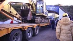 Truck with excavator causing traffic jam, stuck under bridge, Kenya, Africa Stock Footage
