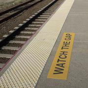 Watch the gap sign at railroad platform edge - stock photo