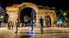 Beautiful ancient Arch of Galerius in Thessaloniki and people that tour. Timelap Stock Footage