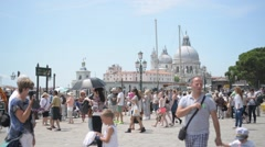 Embankment and pier in Venice and the crowds of people Stock Footage