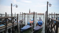 Embankment and pier in Venice and parked gondolas Stock Footage