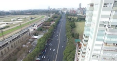 Aerial, panoramic scene with drone of big avenue and green park with lakes. Stock Footage