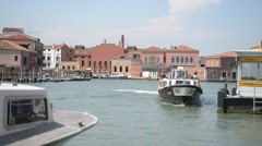 Embankment Pier of island Murano in Venice - The ship is moored to the dock Stock Footage