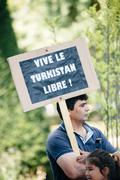 Uyghur human rights activists protest - stock photo