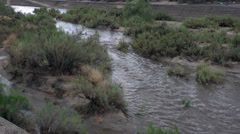 4K UHD flash flood running river in usual desert dry wash Stock Footage