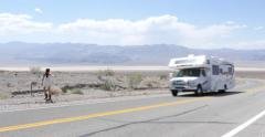 Female Hitchhiker in Death Valley Desert 4K Stock Video - stock footage