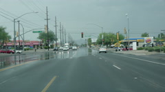 4K UHD flooded intersection with pedestrian after monsoon storm Stock Footage