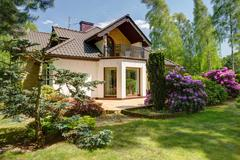 Stock Photo of Detached house and beauty garden