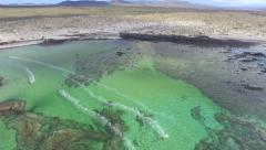 AERIAL: Kiteboarders riding in big beautiful flat-water lagoon Stock Footage
