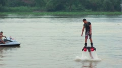 Man Playing a New water sport. Fly Board on chaopraya river Stock Footage