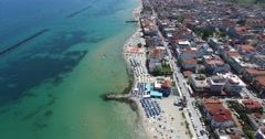 Aerial view of the beach of Katerini in Greece. colorful umbrellas and people wh Stock Footage