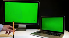 Man Working on the Laptop and Display with a Green Screen  at the Workplace. Stock Footage