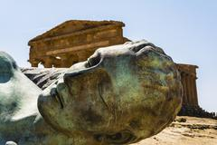 Concordia Temple behind the bronze Icarus sculpture - Valley of temples - stock photo