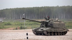 Military tanks driving along the road, Russian military convoy - stock footage