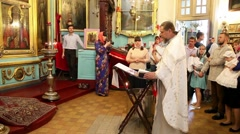 Christening of little baby in orthodox church in Moscow Stock Footage