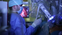 Young male surgeon operating Stock Footage