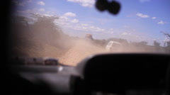 Driving on dusty bumpy dirt road in rural Kenya, Africa savannah Stock Footage