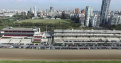 Aerial drone scene of city landscape. Panoramic view of stadium of racetrack. Stock Footage