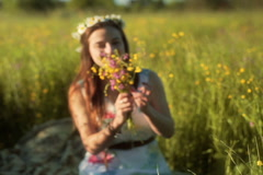 Girl holding bunch of flowers and showing them to the camera Stock Footage
