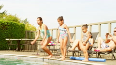 Hispanic family swimming together Stock Footage