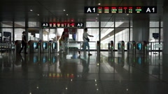 Passengers running to the ticket entrance in CRH railway terminal Stock Footage