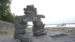 Single Inukshuk on beach - Static shot Stock Footage