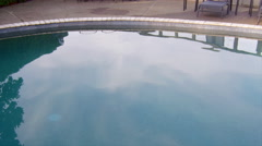 Man jumps into a pool fully clothed Stock Footage