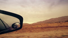 Looking out Side Mirror in Car Driving Stock Footage