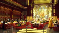 People doing Religious ceremony inside of Buddha Tooth Relic Temple Stock Footage