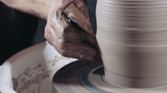 Pottery sculpting a traditional clay pot, close up, tracking shot - stock footage