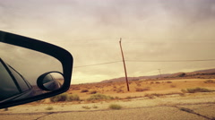 Looking out Side Mirror in Car Driving In Desert - stock footage