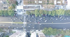 Aerial drone scene of traffic. Cars, public transport and pedestrians movement - stock footage
