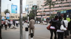 Pedestrian crowd walk in busy intersection, Nairobi city center, Kenya, Africa Stock Footage