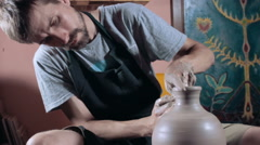 Pottery sculpting a traditional clay pot, wide angle, dolly shot - stock footage