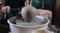 Pottery sculpting a traditional clay pot, wide angle, tracking shot - stock footage