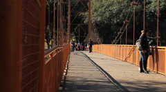 Beautiful old bridge. People walking over a bridge. Stock Footage