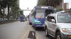 Bus and car traffic in Kenyatta Avenue, Nairobi city center, Kenya, Africa Stock Footage