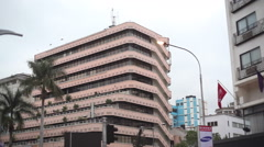 Kimathi House in Nairobi city center, tilt down to busy intersection traffic Stock Footage