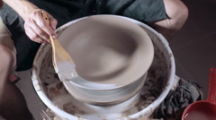 Pottery painting pottery dish, high angle Stock Footage