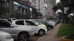 Pedestrians Nairobi city center, tilt up building with antennas, Kenya, Africa Stock Footage