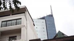 Nairobi city center tower, pan right to Kenyatta Avenue, Kenya, Africa Stock Footage