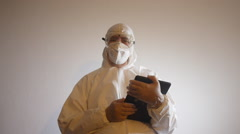 BIOHAZARD LAB TECHNICIAN with Ipad-tablet computer 2 - stock footage